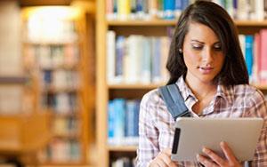 Woman Reading on iPad